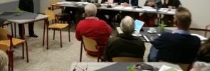 Het AMK bijeen in vergadering